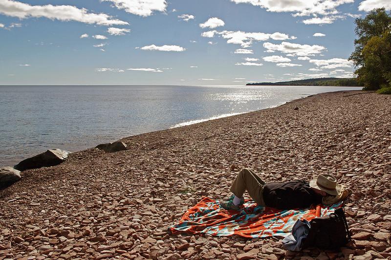 Rita napping on the pebble beach, north shore of Lake Superior, Minnesota.