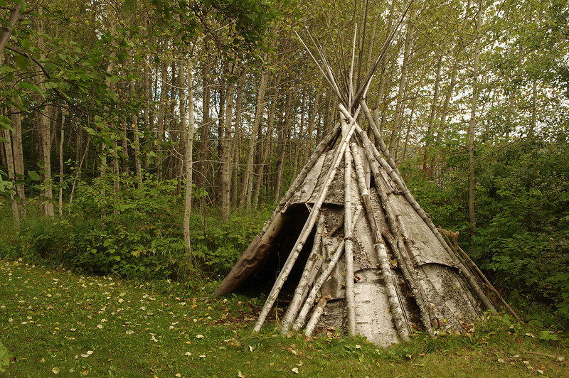 The recreated Ojibwa encampment just outside of the Northwest Trading Company outpost in Grand Portage National Monument. A single layer of birch bark, shown here, is typical of summer tipis; winter tipis were constructed of two layers of bark with insulating moss in between.