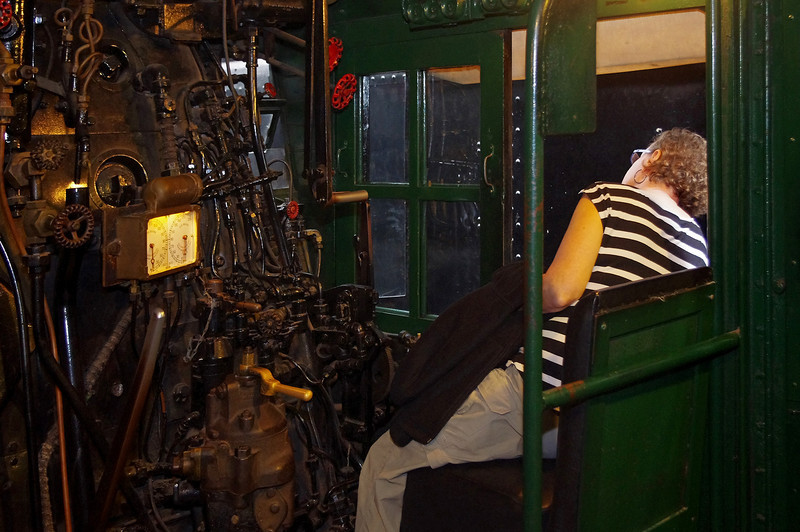 Rita in the drivers seat of a locomotive; Lake Superior Railroad Museum at the Duluth (Minnesota) Union Depot.