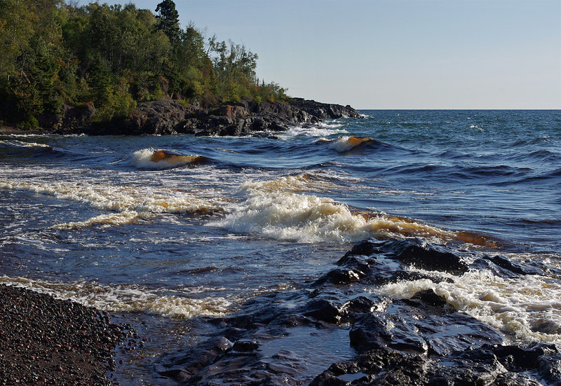 Waves on the north shore of Lake Superior, Temperance River State Park, Minnesota. The root beer color of the water is due to the tannic river water entering the lake.