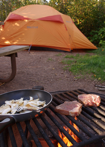 Our walk-in tent site in Tettegouche State Park (Minnesota), with steaks on the grill.