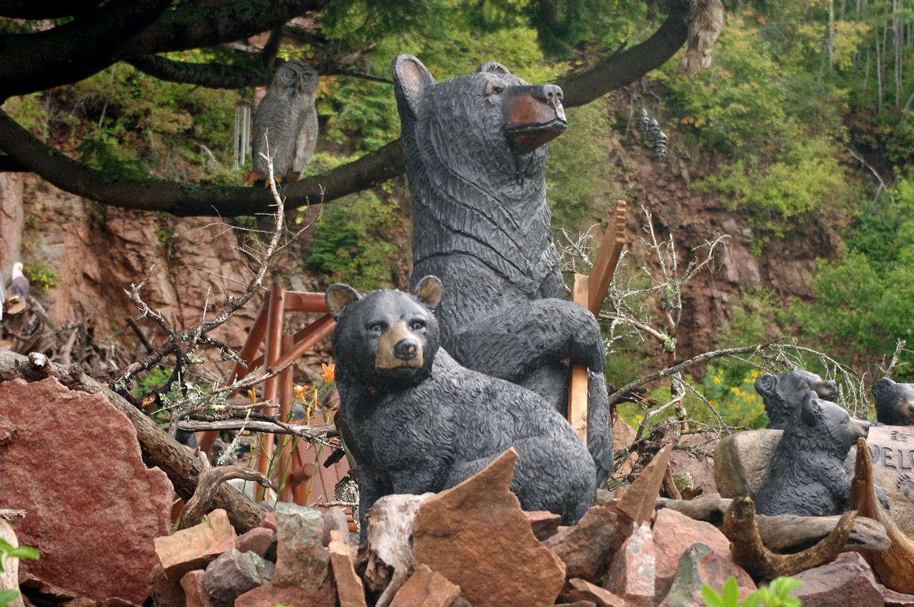 Family of wooden bears in the front yard of a residence on the North Shore Scenic Route. Lake Superior, Minnesota.
