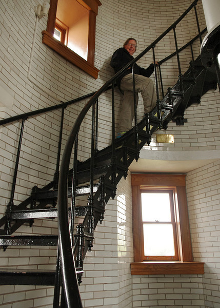 Rita climbing the spiral iron stairs inside Split Rock Lighthouse, Minnesota.