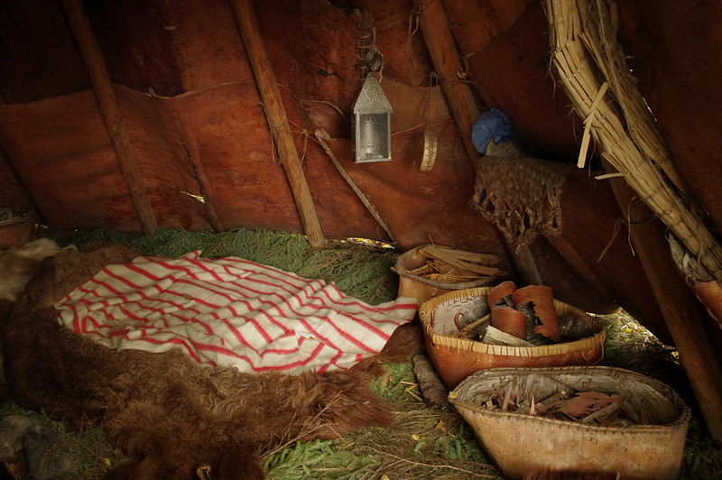 Inside one of the Ojibwa's birch bark tipis.  Furnishings are as they would be in about 1815.