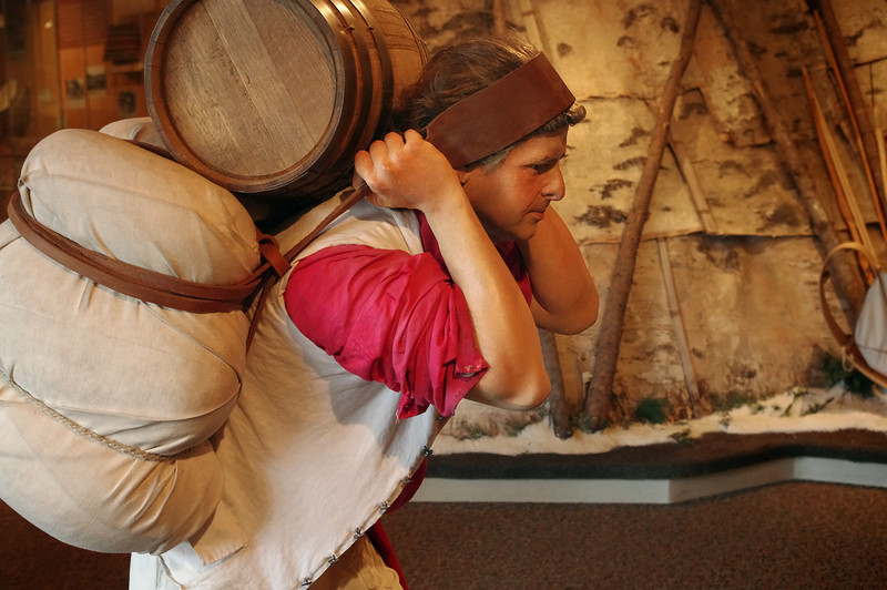 Voyager using a trumpline to haul supplies. Interpretive center, Grand Portage National Monument, Minnesota.