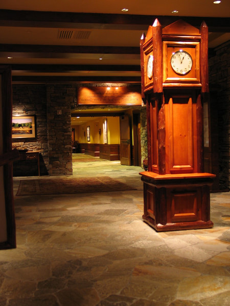 This is a 4-sided grandfather clock in front of the elevators.