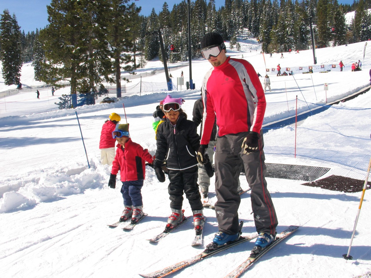 Resya and Rithik getting ready for their first time going down a slope on skis!