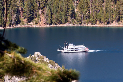 A paddle boat touring Emerald Bay.