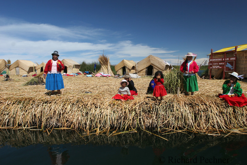 Family of Lake Uros on one of the reed islands