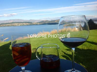 DRINKS while enjoying view of Lake Wanaka from Lodge.