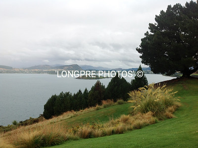 Rainy day view of town of WANAKA.  Across the lake.