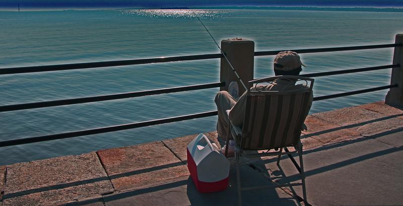 Fishing on East Battery .  Charleston Harbor, South Carolina