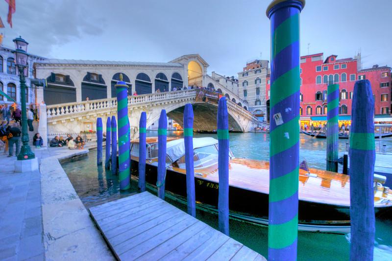 Rialto Bridge mid day w/ fantastic teak water taxi . Love the ''barber poles '' too.