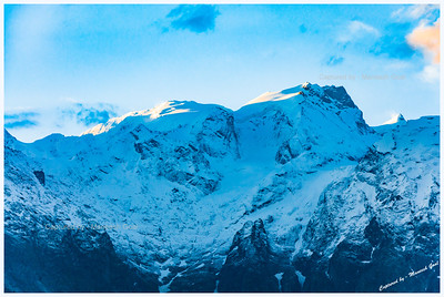 First rays of sunlight on the mountains of the Kinner Kailash range