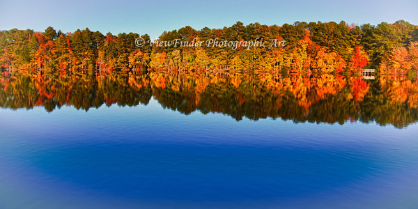 The reflection of fall foliage doubles the beauty of fall colors at Sandy Bottom Park in Hampton, VA.