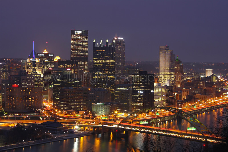 Downtown Pittsburgh and the Fort Pitt Bridge<br /> <br /> One of the main arteries into the city, the Fort Pitt Bridge welcomes visitors and locals alike to a one-of-a-kind view of the city as it blossoms in front of their eyes as they emerge from the Fort Pitt Tunnel.