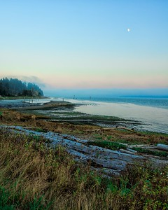 Moonrise over Comox shore Vancouver Island BC