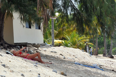 Reading a book while sun bathing on the inviting beaches of Langkawi, Malaysia
