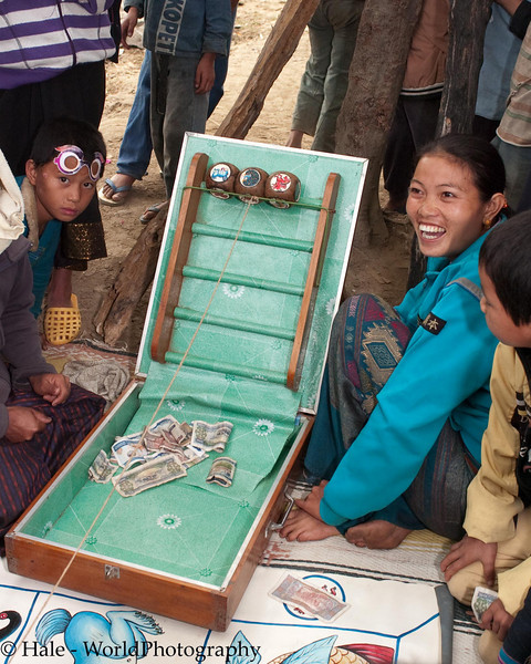 Young Woman Smiling - She Owns The Gambling Dice Game - A Certain Winner, Ban Thin Thad, Laos