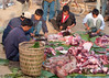 Lanten Men Preparing Pork and Beef For New Years Feast, Ban Tin Thad, Lao People's Democratic Republic