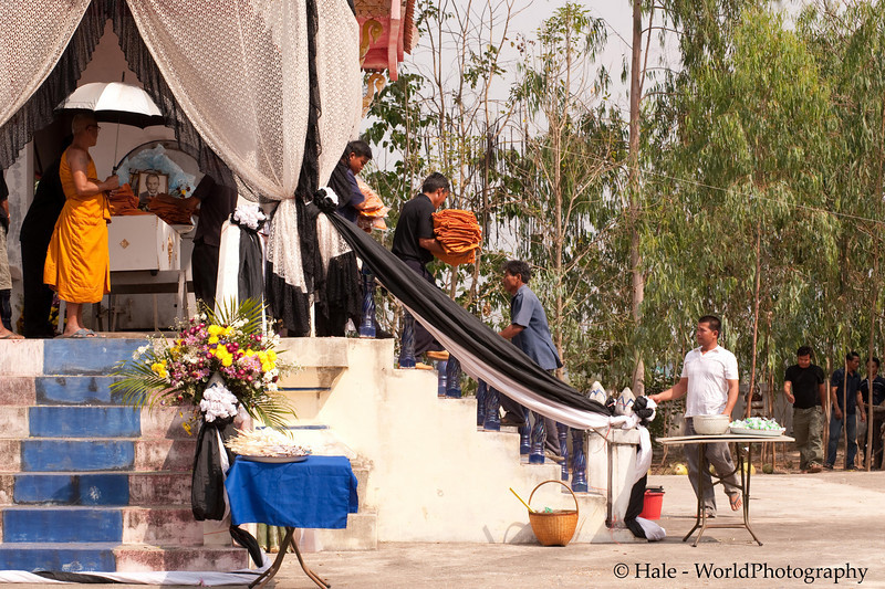 Offerings of Hand Towels Are Removed from the Coffin To Be Given to the Monks