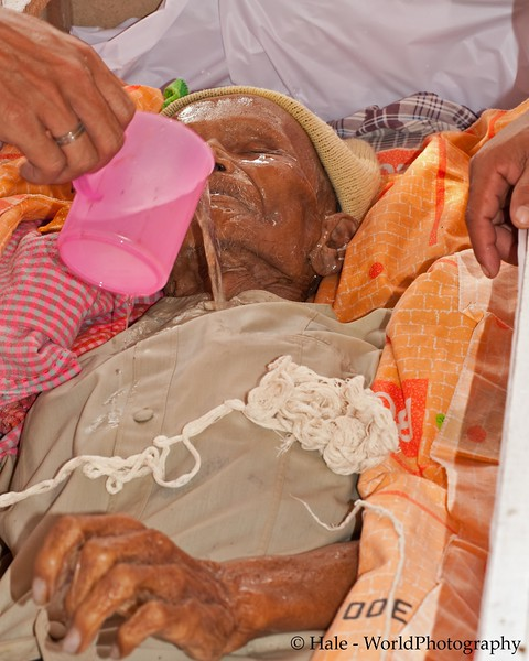 A Relative Pours Coconut Water Over The Corpse, Tahsang Village, Thailand