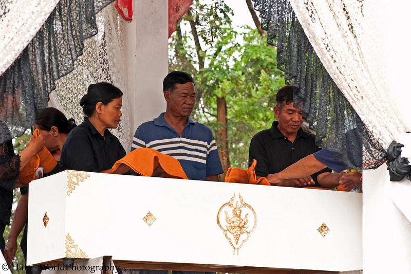 Placing A Hand Towel Offering Atop the Coffin