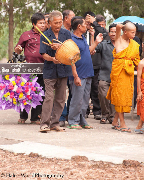 Spreading Popped Rice Ahead of the Coffin During Circumambulation of the Crematorium Three Times