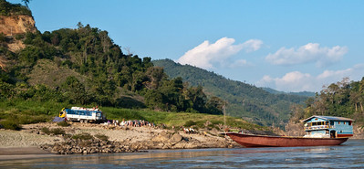Houei Xai to Louang Prabang: Two days down the Mekong - manual loading of Cargo boat.
