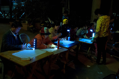 Luang Prabang to Luang Namtha: Nightime Lottery Sellers
