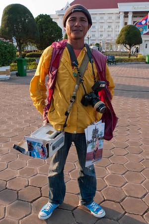 Vientiane: Photographer with photo printer