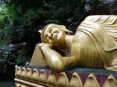 Reclining Buddha near Wat on Mt. Phousi