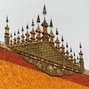 Unique roof finials on Luang Prabang temples are symbols of the universe and sacred Mt. Meru.