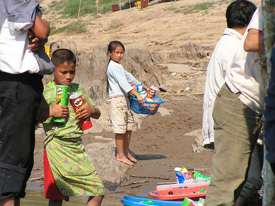 Loas. Little kids selling beer to the tourists floating down the Maekong