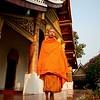 Golden hour portrait of a saffron monk.