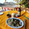 A typical Laos meal on the bank of the Mekong river.