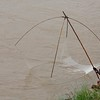 The traditional way to catch the tiny reil fish in the Mekong.