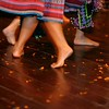 Traditional dancers whirl around the polished wooden floor.