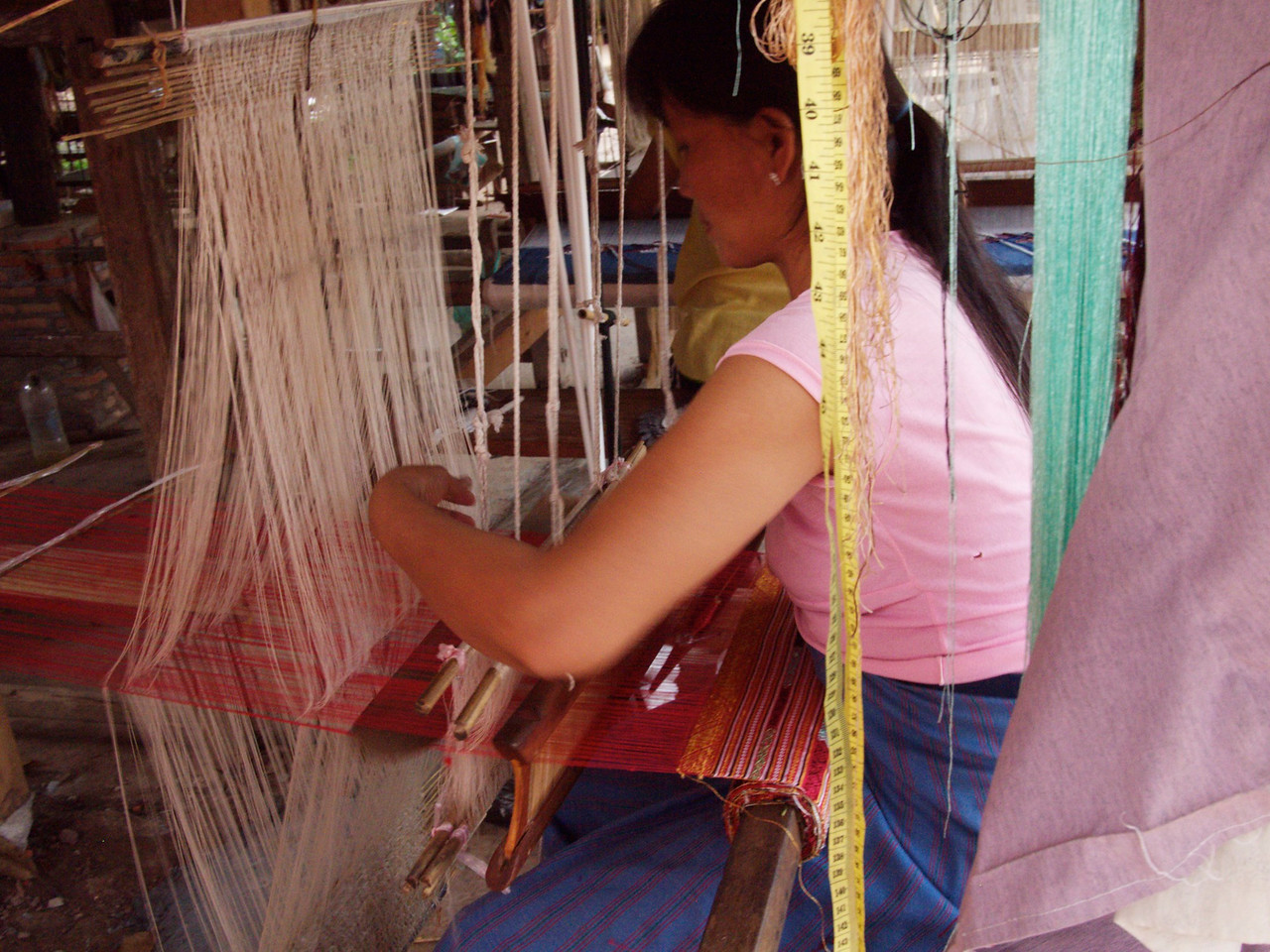 we rode bikes to a village known for weaving. the lao people make beautiful scarves and tapestries out of hand-died silks