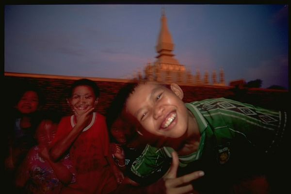 Kids sunset over  Wat in Vientiene, Laos