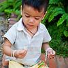 Child eating grubs