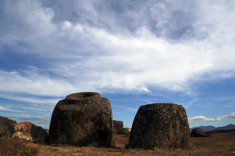 Megalithic jars at the Plain of Jars (Site 1), Phonsavan. The jar at left is over 2 metres tall and weighs approximately 10 tonnes.