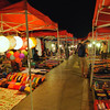 Night Market, Luang Prabang.<br /> <br /> Luang Prabang's main thoroughfare, Sisavangvong Road, closes for traffic after sundown everyday. Artisans from nearby villages gather here to display their wares. Among other things, you will find Lao textiles, fashion accessories, local and French gastronomical delights.