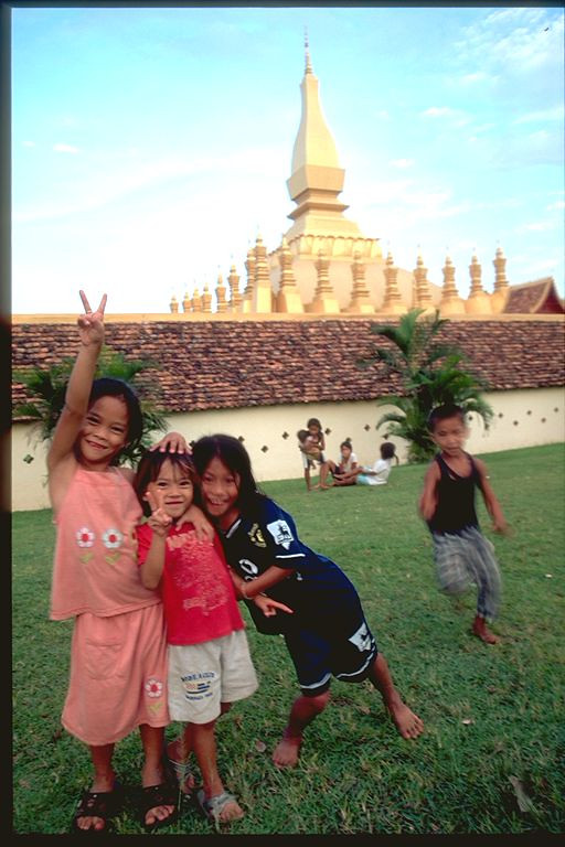 Kids posing near  Wat in Vientiene, Laos