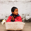 Living on the benevolence of others, this street urchin waits for the monks to drop off some of the alms they have collected.