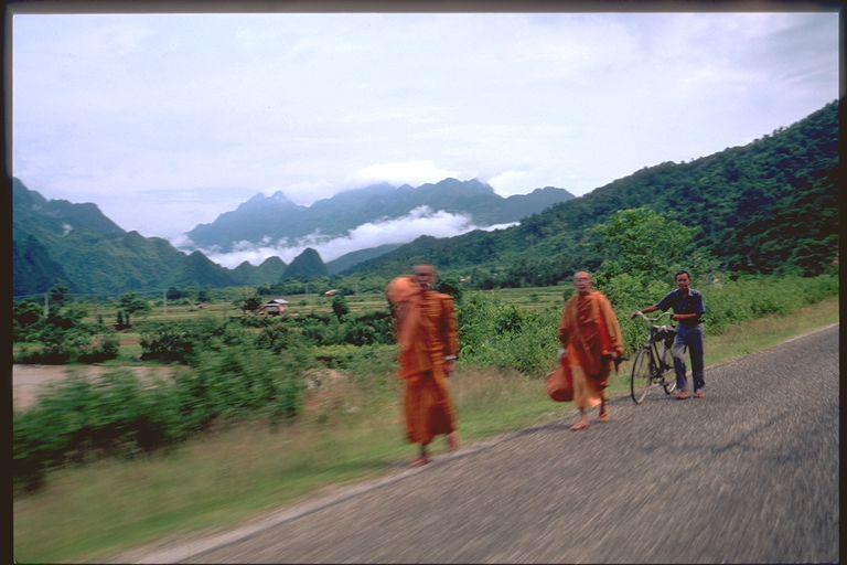 Monks walking the roads in Laos
