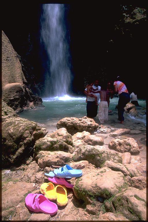 Shoes and waterfall in Luang Prabang, Laos