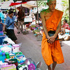 Monk with alms container
