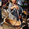 Viet womanwith typical method of carrying a load