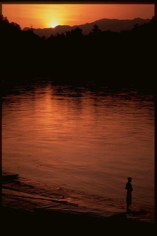 Mekong river sunset and one man in Luang Prabang, Laos